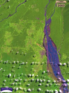 In 2003, Landsat detected a very different scene as tailings (waste rock) from the colossal Grasberg copper/gold mine are legally dumped into the river for disposal. Learn more here.